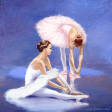 Two little ballerinas tying their shoes.