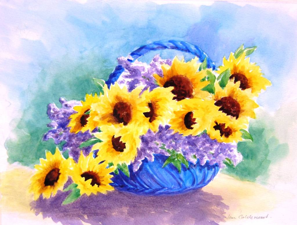 Sunflowers and lavender in a blue basket.